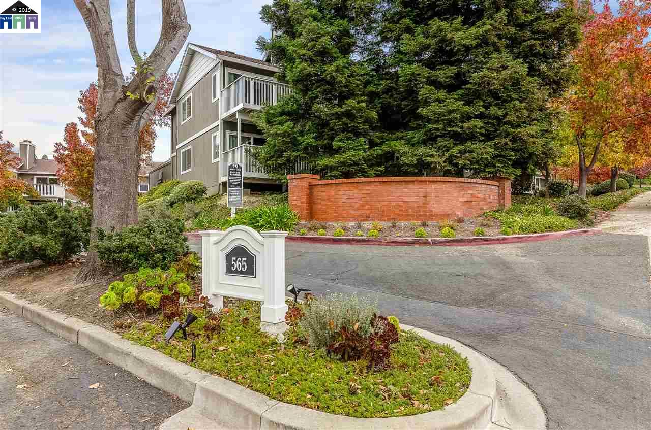 Beautifully remodeled upper-end condo backing up to Lori Drive gives the feel of seclusion and offer