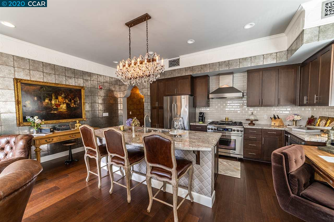 Located in the heart of charming downtown Danville, this rarely-available executive condo was built in 2015 in the historic Danville Hotel. An open layout has been thoughtfully created with quality touches such as custom wallcoverings, updated light fixtures, wide-plank hardwood flooring & oversized decorative molding. Stunning gourmet kitchen opens to a large living/dining area, with doors leading out to a private balcony. The gourmet kitchen offers Dacor stainless steel integrated appliances, granite counter, subway tile backsplash, and a stunning designer center island with sink and breakfast bar. The master suite is truly exceptional, with glass chandelier lighting, a walk-in closet and spa-inspired master bath.  The location is ideal, just steps from downtown Danville's charming shops, renowned restaurants and upscale amenities, as well as farmer's market, walking trails and top-rated schools.