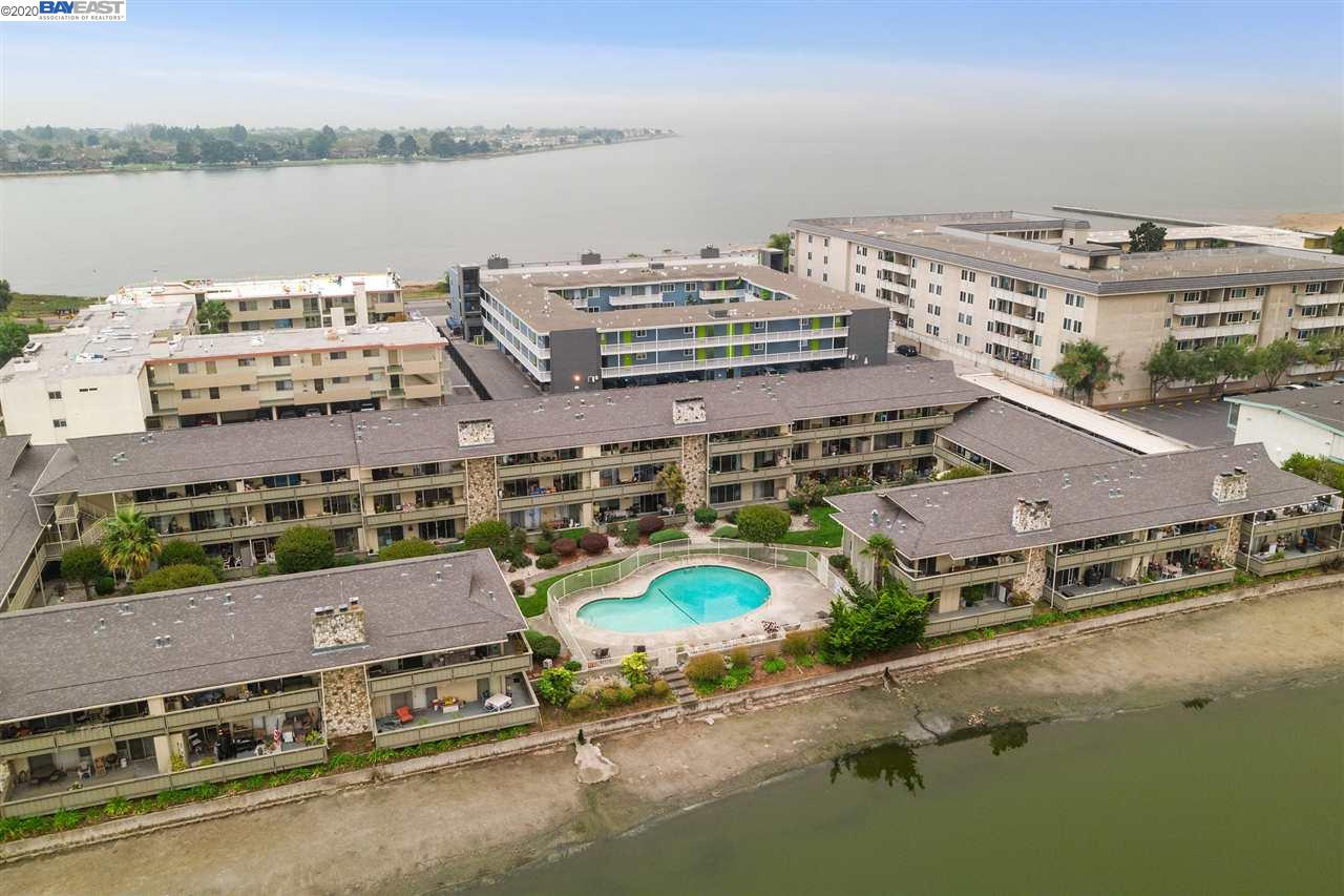Superb location - Near the lagoon and SF Bay! Step out your door to walking and bike paths and the bay and enjoy the bird sanctuary, kite surfers, kayakers and sun bathers. This top floor, east facing unit is private and light with a lagoon view from the living room & kitchen. A spacious condo, over 929 sq. ft., has large rooms, a beautifully remodeled kitchen with birch cabinetry & quartz counter tops, and an updated bath. The large balcony that runs the length of the kitchen and living room has two sets of sliding glass doors adding extra living space and visually make the living room feel even larger. In addition to abundant closet space, there is balcony and carport storage and an extra storage room down the hall, as well as additional community bike storage. Just a 5 minute walk to Park Street or South Shore Shopping Center - cafes, grocery stores and shops are at your finger tips. Easy access to 880 freeway, AC Transit to SF, Oakland and Berkeley or Ferry.