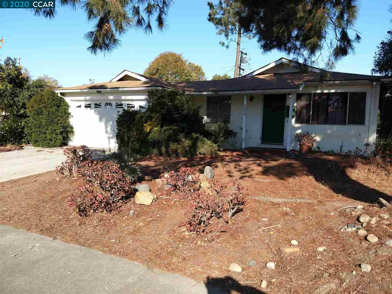 OPPORTUNITY IS KNOCKING. Take this charming fixer-upper original configuration home and remodel to your own personal preferences. Its a former rental, a little worn and dated inside. Space for possible Boat or RV parking on side yard.  Bring All Offers !