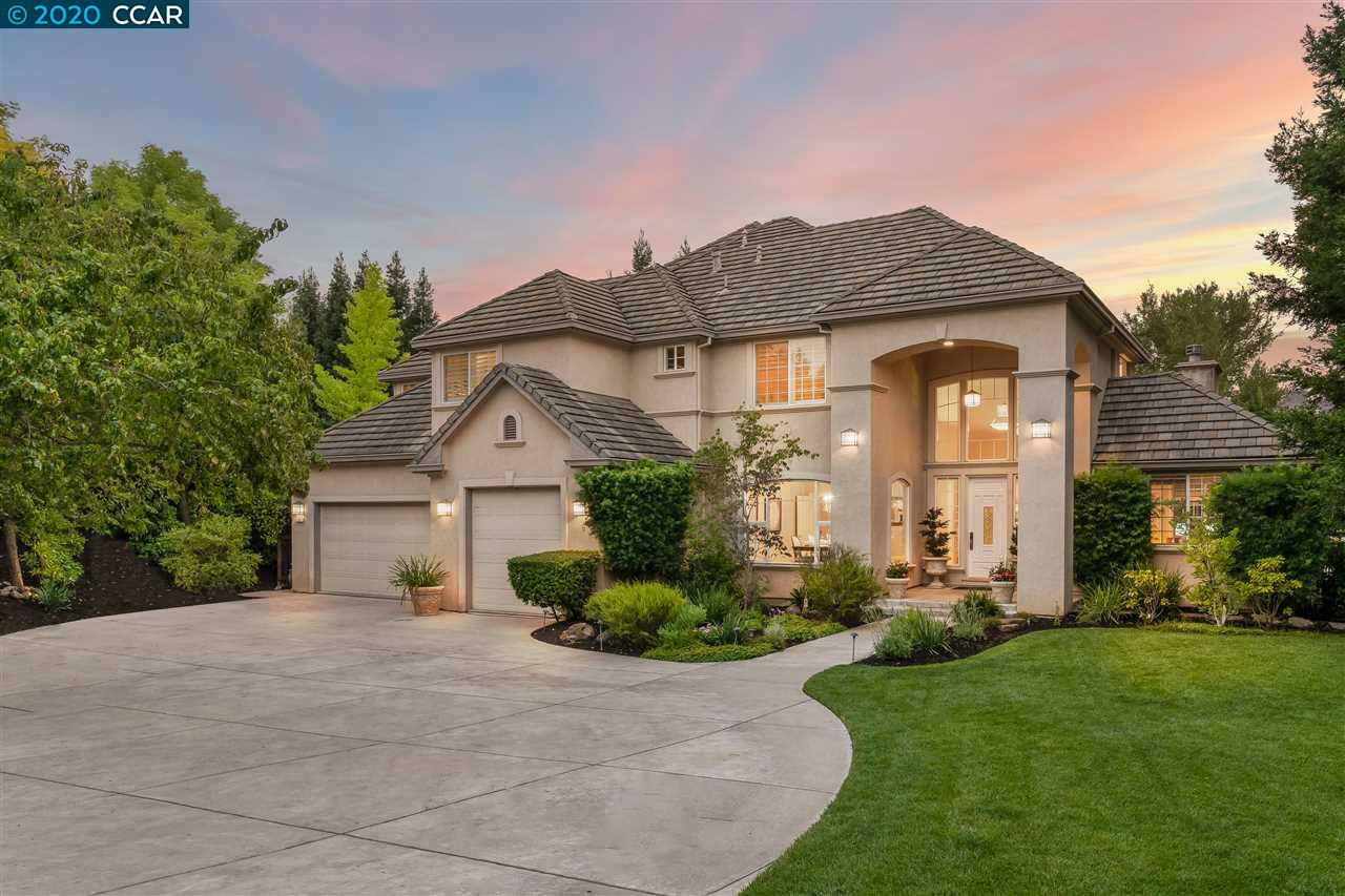 Upgraded home on private street in desirable Alamo, just minutes from Roundhill CC. Built to entertain w/dream backyard w/sparkling pool & spa, pavilion w/built-in kitchen, tv, heaters, surround sound, bar seating & stone patio w/fire pit, perfect for relaxing w/friends & family. Open floor plan boasts grand entryway w/soaring ceilings, new hardwood floors & carpet, elegant dining room, living room w/gas fireplace & upgraded kitchen, dining nook & family room w/fireplace & wet bar. Beautifully appointed Chef's kitchen boasts new Carrara counters, white cabinetry, stainless steel appliances, walk-in pantry & center island w/bar & prep sink. Stunning elements include hardwood floors, plush carpet & plantation shutters. 2 desirable downstairs bedrms, one w/french doors perfect as office & other w/full bath great for hosting guests. 4 upstairs bedrms including master retreat & oversized bedrm perfect for bonus/media room. Close to shopping, dining, trails, top-rated schools & freeway.