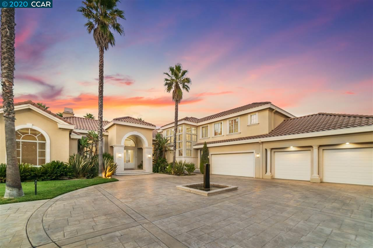 Custom gated estate in Blackhawk CC. Full acre lot features grand circular driveway lined w/palms, modern fountain & 4 car garage. Dream backyard w/views of hills, pool/spa, wet bar/bbq, cabana, lawn area & backs to open space. Custom finishes include marble & hardwood floors, stunning living spaces w/designer lighting & picturesque windows w/views. Family/kitchen combo w/vaulted ceilings, wet bar, dining area. Chef's kitchen boasts white custom cabinets, granite counters, SS appliances, center island, butler's pantry & breakfast bar. Dwn master bed has gas fireplace, sitting area, 2 walk-in closets & access to backyard. Ensuite offers marble floors & counters, soaking tub & large shower. Addl. features include office w/built-in shelving, dwn bedrm/office & upstairs bonus rm. Home has leased solar, owned solar for pool, interior & exterior speakers. Blackhawk living w/2 golf courses, clubhouse, fitness center & tennis courts. Close to parks, trails, Blackhawk Plaza & top SRV schools.