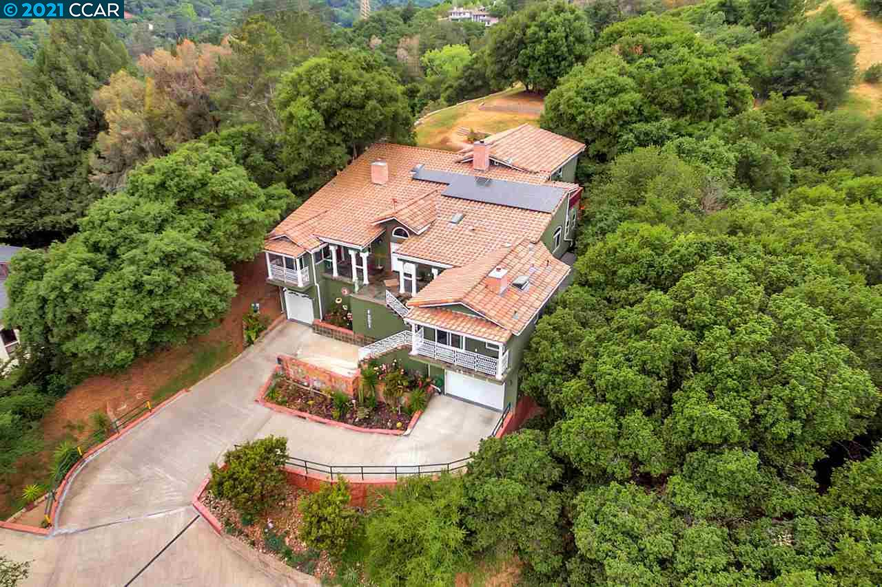 Privacy and security in your own country estate just 25 minutes BART ride from downtown SF. Five acre lot with mature forest allows an incredible opportunity to explore nature. Nearby to all the top rated K-12 Orinda schools. Beautifully situated up on a knoll with magnificent scenic views from East to West, this stunning 2010 custom home boasts 5-bedroom, 3.5 bath and over 4,000 sqft of exquisite livable space.  Many imported features such as hand carved columns and doors from the Philippines to Italian marble floors. Executive office for working at home. The entertainer's kitchen is ideal for large gatherings. A large family room with a built in stage.  Additional 7 attached decks create over 1000 SF of outdoor living space. Energy-efficient features include gas water heaters,  a 5,000 gallon water tank with dual pumps and a 27-panel solar roof.