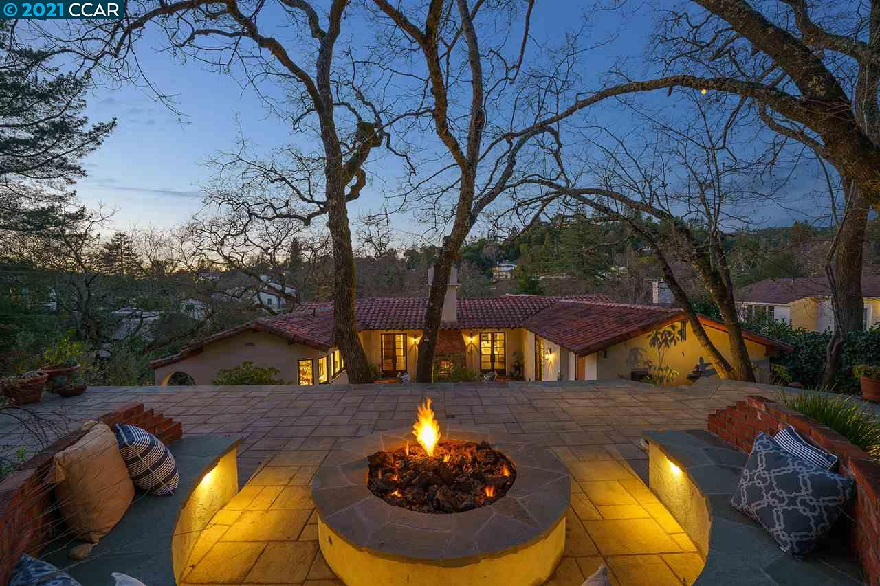 Perched above Lake Cascade with serene views, this gracious Spanish style 1930's home has been extensively updated throughout with quality materials and masterful craftsmanship while preserving the original architectural integrity. Experience quintessential CA living in an excellent floor plan with two living rooms, primary bedroom room and chef's kitchen opening to outdoor entertaining venues. Distinctive features include beautiful wood beamed ceilings, elegant French doors that invite you to the brick courtyard with fireplace, upper courtyard with fire pit, terraces with views, built-in BBQ and a walk-in wine room.  Spring is around the corner and the garden is on the verge of emerging. Award-winning landscaping includes specimen trees, fruit trees, custom hardscape & magical evening outdoor lighting. Ideal location: the lake at your doorstep, quick access to Orinda Country Club, shops & restaurants, community center, farmer's market, BART & HWY 24. Truly an enchanting home.