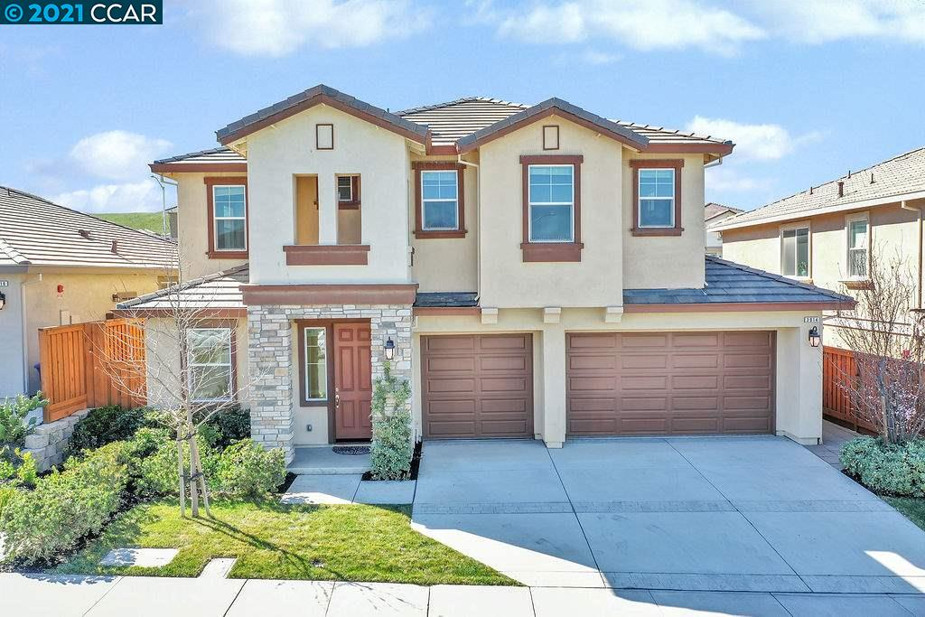 Nestled in the beautiful hills of the desirable San Marcos neighborhood you will find this magnificent 5 bed, 3 1/2 bath home. The kitchen features gorgeous granite countertops accented with dark, warm cabinetry and a large granite island that can easily sit your entire family! This home is an entertainer's paradise. A fully landscaped backyard with its own vegetable garden that commands privacy, with spectacular views of the rolling hills brings entertaining outdoors! This home also features two Master retreats with large walk-in closets and separate shower and soaking tubs. OneJr Master suite on the lower level. Upstairs you will find a spacious loft and 3 additional bedrooms plus a large full bath located upstairs as well as upstairs laundry for ease and convenience. This home is 3500 sq ft of sophisticated, unparalleled, elegance and yet, so welcoming. The backyard has  enough room to entertain, play soccer and run around, hard to find with new construction these days.