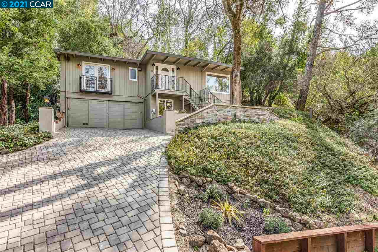 Charming ease of living home at end of private cul-de-sac in prime Country Club area off Miner Rd surrounded by more expensive properties. Stylish decor interior w/ refinished wood floors; dual pane windows' spacious updated kitchen w/central island, new appliances; brick fireplace in large living room full of windows, vaulted ceilings. Bonus +183 sqft lower floor office. Tranquil views with French door access to lovely terrace courtyard + privacy.  Truly a gorgeous setting w/fire pit, exception allure. Walk to Orinda Village, Wagner Ranch Elementary School & BART all nearby off beautiful long lane from the street. .