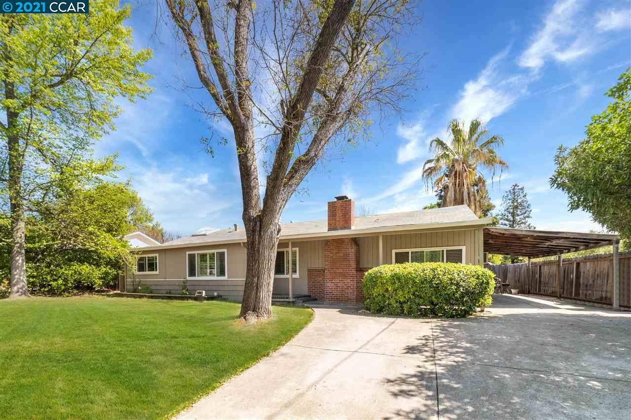 This charming single level home is tucked away in the desirable Cameo neighborhood of Danville. This property offers endless possibilities with an oversized flat premium lot and backs to Diablo Country Club with golf course views! The traditional floor plan offers hardwood floors, a formal living room with a fireplace, a spacious family room with a brick fireplace, and a light-filled kitchen that opens to the backyard. The expansive backyard features a beautiful deck, large lush lawn, and has ample space to build a pool, or your dream home. Conveniently located within a short distance of award-winning schools, downtown Danville, golf courses, parks, trails and the freeway.