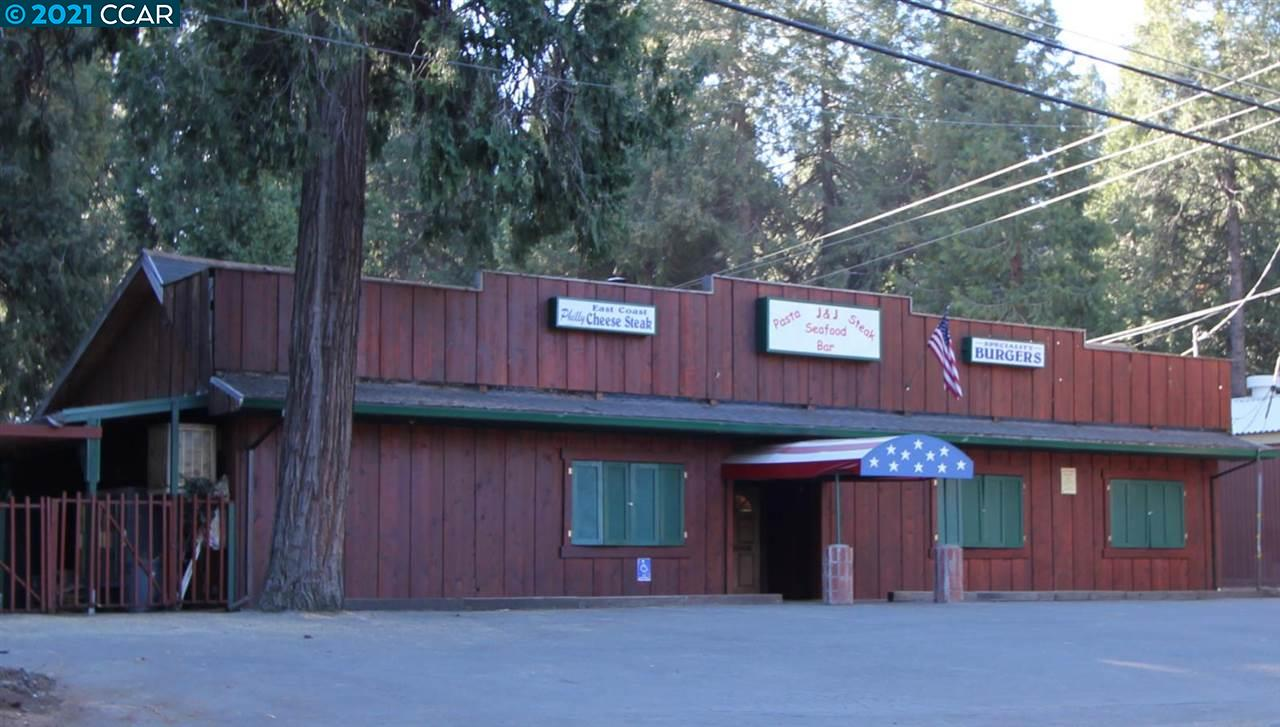 Opportunity knocks! Prime .63 acre parcel zoned commercial/mixed use! Cabin style bldg offers 2900 sqft plus a 1 BD/1BA apartment. Possibilities are endless! Could be perfect for a sporting goods store, bar & grill or a small market! Ideally situated with excellent road frontage, close to the Best Western, Hwy 50 & more! Full service kitchen offers a walk in refrigerator w/newer motor. Ample parking in front, back and behind the building. Great potential!