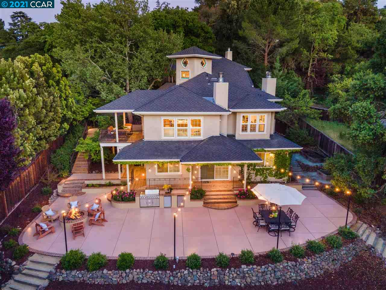 Beautiful custom designed gated home in hills of Walnut Creek, w/private setting/hillside views. On over ½ acre, expansive backyard:built-in BBQ/kitchen, covered deck, multiple patios, bocce ball court, garden beds, garden shed, gas fire pit & mature landscaping. Stunning elements: soaring ceilings, hardwood floors, picturesque windows & natural light. Open floor plan:spacious living room w/fireplace, elegant dining room, executive office w/built-in desks/shelving & large family room overlooking backyard. Gourmet kitchen: granite counters, custom cabinetry, high-end appliances, two sinks, center island w/range & custom hood w/access to deck. Master retreat:sitting area, gas fireplace, private deck w/hot tub & french doors to spa-like ensuite w/separate vanities, jetted tub, glass-enclosed shower & walk-in closet. All secondary bdrms are ensuite & generous in size. Wine cellar, perfect for entertaining guests. Close to downtown Alamo Walnut Creek, Broadway Plaza, freeway & BART.