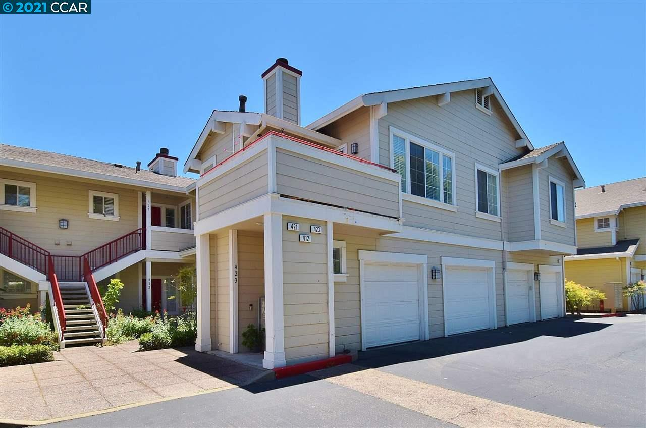 Lovely top floor condo with amazing panoramic views of the San Ramon Valley hills! Features a garage and an extra parking space, large windows in the living room to let in lots of natural light, a fireplace, balcony, and updated flooring throughout. Kitchen has quartz countertops, newer appliances, and white cabinets. Two master suites, both with walk-in closets and upgraded baths. HOA includes water and trash removal. Close to award winning schools and the 680 freeway. This is one you won't want to miss!