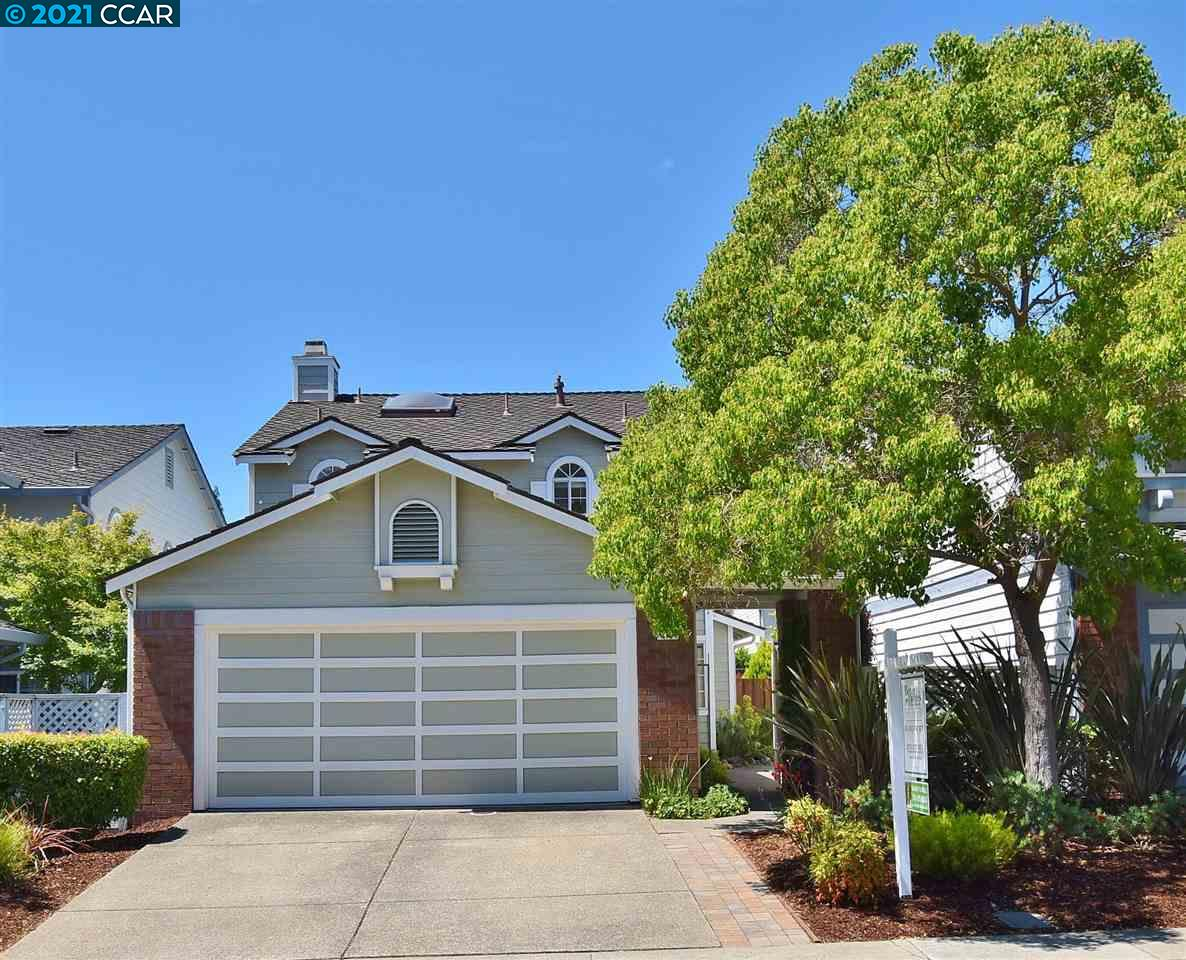 Detached light filled home located in the Newcastle neighborhood of San Ramon. This well-maintained home features an open floor plan, updated kitchen with stainless steel appliances, built-in microwave, cherry wood kitchen cabinets and eat-in dining nook. Master bedroom suite with vaulted ceiling, picturesque windows, walk-in closet, and dual sinks. A formal dining area with large bay windows, great for natural light leads to a spacious family room featuring gas fireplace with tile hearth.  New laminate floors throughout the downstairs.  Large Skylight over spacious landing and stairs area. Beautifully landscaped backyard with brick patio, Arbor and lush lawn area. Close vicinity to Marketplace Center, Central Park, Bishop Ranch City Center, the Iron Horse Trail and San Ramon's top-rated schools. Minutes away from freeway access and easy commute. Low HOA at $177 a month - amenities include Pool, Playground, and front yard (outside of gate) maintenance.