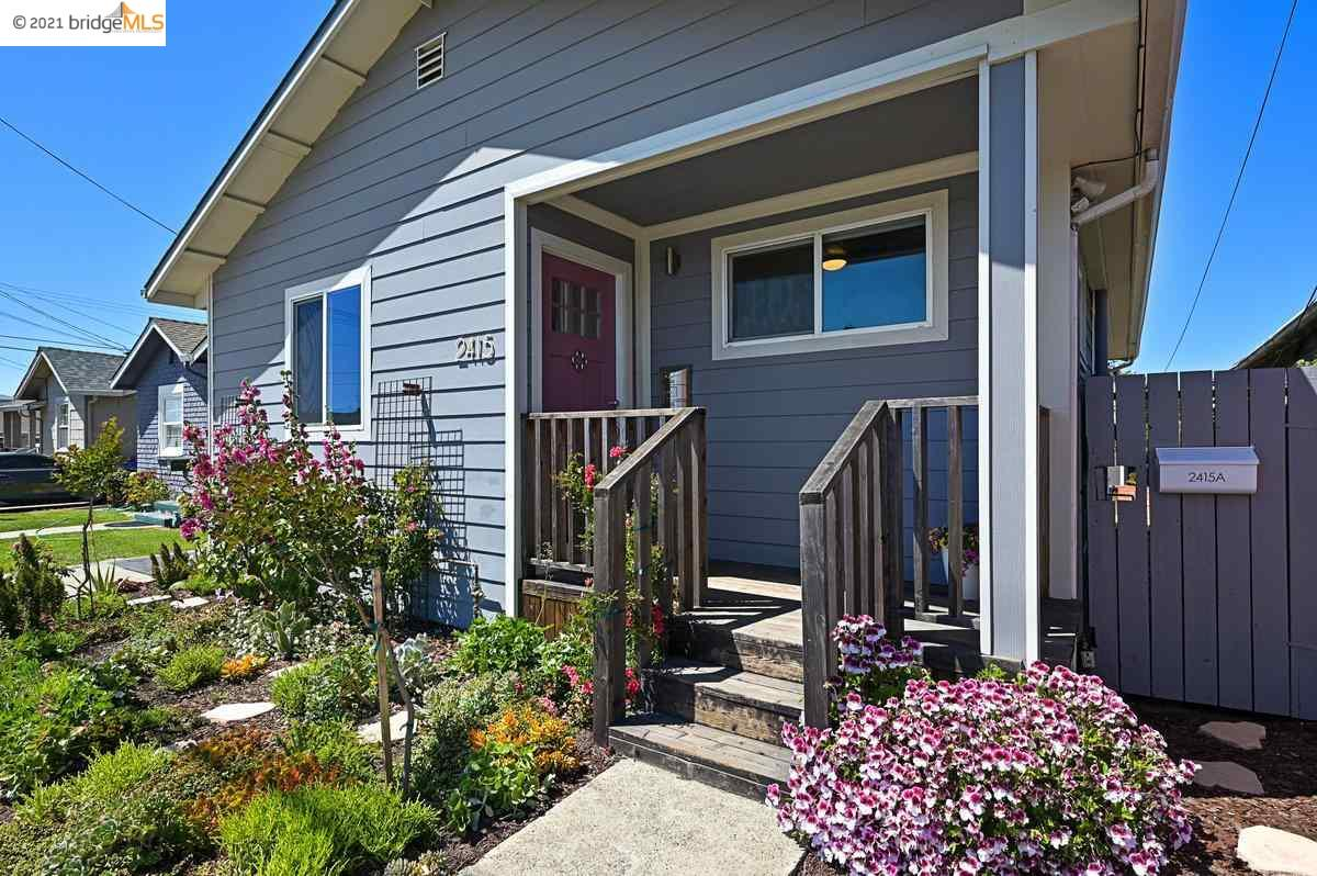 With two structures on one lot, this is the perfect opportunity for investors or homeowners who need some extra space and privacy. Framed by a beautiful front succulent and flower garden, the main house boasts an extra large living/dining room space that is wide open to a well-appointed kitchen. Recently remodeled yet keeping some on its original charm, the home offers 2 spacious bedrooms and a bathroom in about 975 sqft. The house features newer flooring, windows, bathroom, roof and owned solar panels.  Past the gated driveway and side pathway is a backyard featuring built-in benches, perfect for your entertainment needs. Extending from the garage (zoom room?) is a 552 sqft rear cottage offering full independence with its bedroom, kitchen, bathroom and separate gas/electric meter. . Conveniently located by the 23rd St. shops and popular Wildcat Creek Trail system. Easy commute via San Pablo Ave. and hwy 80.