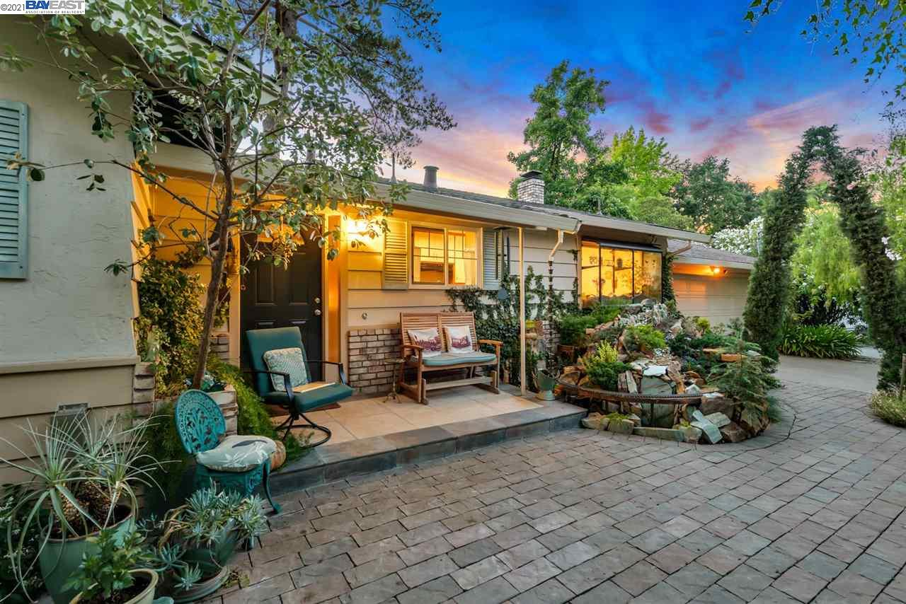 Welcome home to this charming beauty tucked quietly in the heart of Pleasant Hill. Located at the end of cul-de-sac, surrounded by mature landscape and custom arbors, this home guarantees the utmost privacy. The landscape includes numerous fruits trees that produce in plenty and a greenhouse to grow your own additional veggies! Don't miss the hidden outside shower, located in the backyard behind the red unit. Original hardwood floors, energy efficient windows, spacious land and room to make this home your own....you will fall in love with the layout of the home, quiet perfection, top-notch location, and retreat-like setting!