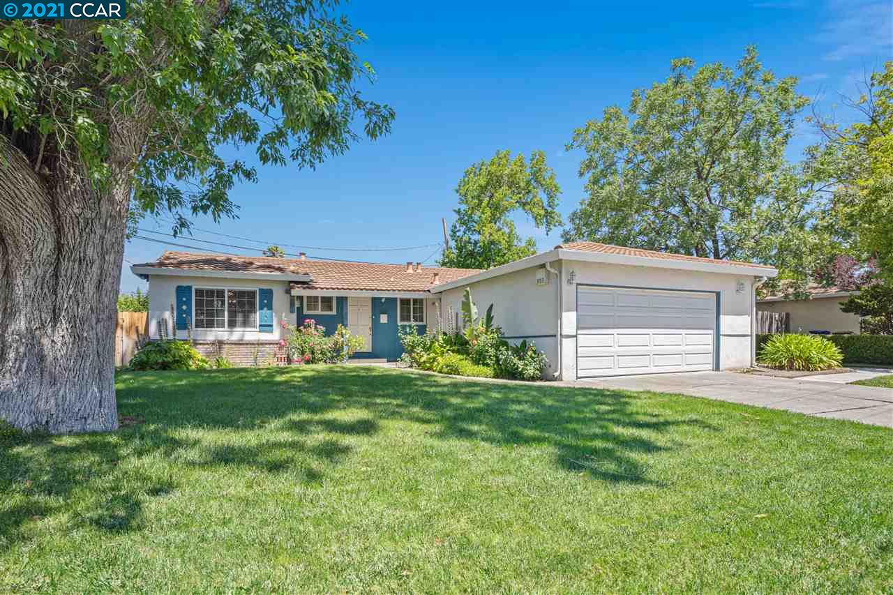 Beautiful nice one story home or a large corner lot with pool.  Freshly painted with new carpet.  Upgraded kitchen.  White picket fenced front yard with beautiful front lawn.  Great opportunity to get started in home ownership. Nice deck and covered patio.  Oversized garage. Built-in Alarm System