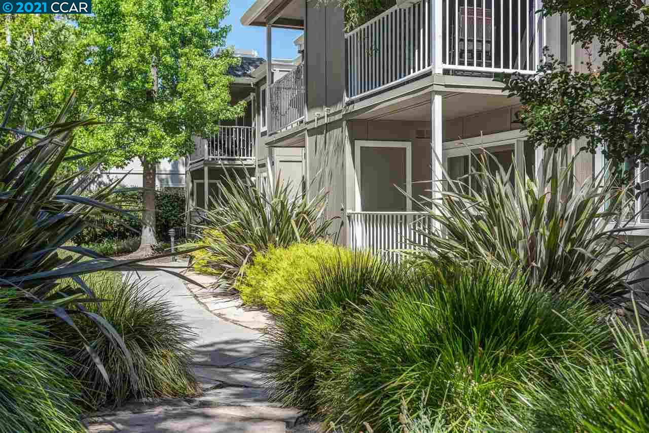 A must see! Highly desirable 2BD/1BA ground floor end unit built in 2015 which is move in ready.  Enjoy the serene setting of this condo which includes a patio area overlooking the landscaped grounds. The treelined courtyards offer a warm and inviting surrounding with a community pool just a short distance from the front door.   Terrific location close to shopping and restaurants. Great commute location close to BART and freeway access.