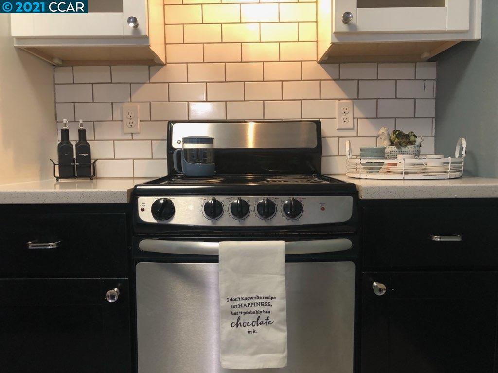 Stainless Appliances & Tile Backsplash