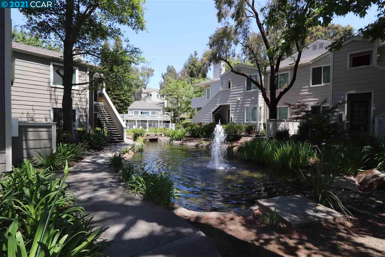 Open Sunday 1-4 – Reasonably priced and very desirable Foothill complex in San Ramon, 2 bedroom suites with full bathrooms, laundry with stack washer & dryer, 1 car detached garage plus a parking space, Community pool & Spa with a club house, Large living room with fireplace and French doors to the patio deck, Lots of storage, separate dining area, the unit is 1,179 sq. ft., large kitchen with refrigerator, elec. Stove/oven, Large deck over looking the streams that run through the complex. This property in one story lower end unit with water fall & stream right out the front door. Close to shopping, GOLF, Parks, schools, excellent restaurants and easy access to all local freeways. Dublin BART is just a few miles away. Don't miss this property, lowest price on the market.  Remember, Open house Sunday 1 to 4 please stop by.  Any question just call the listing agent my sign is in the window.