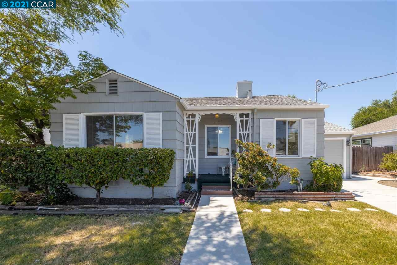 This charming bungalow home is as cute as it gets! Hardwood floors through living space & both bedrooms, brick fireplace, country kitchen with tons of light, and spacious backyard. Super convenient location with easy access to freeway and public transportation/BART. This home is ready to be made your own. Hurry, it won't last long. OPEN HOUSE Sunday July 11th from 1-4