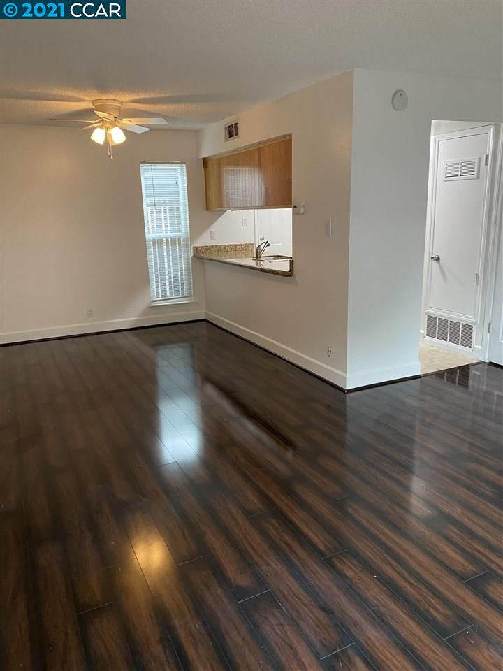 Beautiful, newly renovated Roundtree townhome!  Investors welcome!  Great area, close to restaurants and shopping.  A must see!  New windows, newer carpet, newer dark walnut flooring, private storage on patio, refrigerator included! Community pool, beautiful greenbelt. One designated parking stall. Ample street parking, open parking for second car.