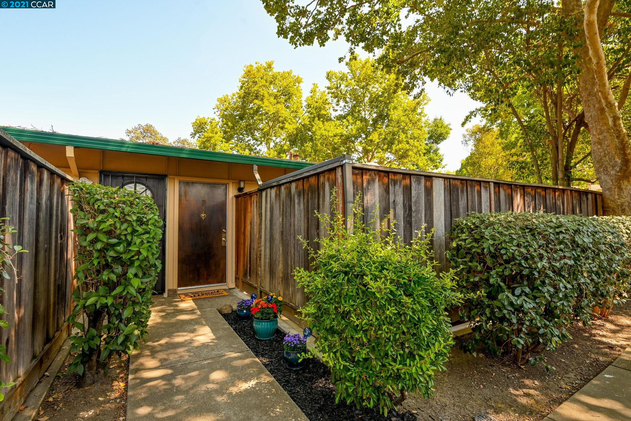 PRICE REFRESHED! OPEN HOUSE Saturday, 9/11 11am-1pm. Here is your chance to enjoy the benefits of living in the delightful City of Walnut Creek! You'll love living in this darling, ideally located single-level condo. It's nestled toward the center of a quaint and quiet complex of only 40 units, featuring mature landscaping and a sparkling swimming pool. Enjoy fresh new carpet and paint while gazing out a 12-foot-wide slider leading to a spacious and private patio, great for entertaining and relaxation. Other features include plenty of closet space, an outdoor storage closet, inside laundry potential, a covered parking space, and an extra storage unit in the carport area. In addition to access to top-rated schools, shopping, entertainment, restaurants, and recreation, the home is adjacent to Iron Horse Trail and within walking distance to Pleasant Hill and Walnut Creek BART stations.