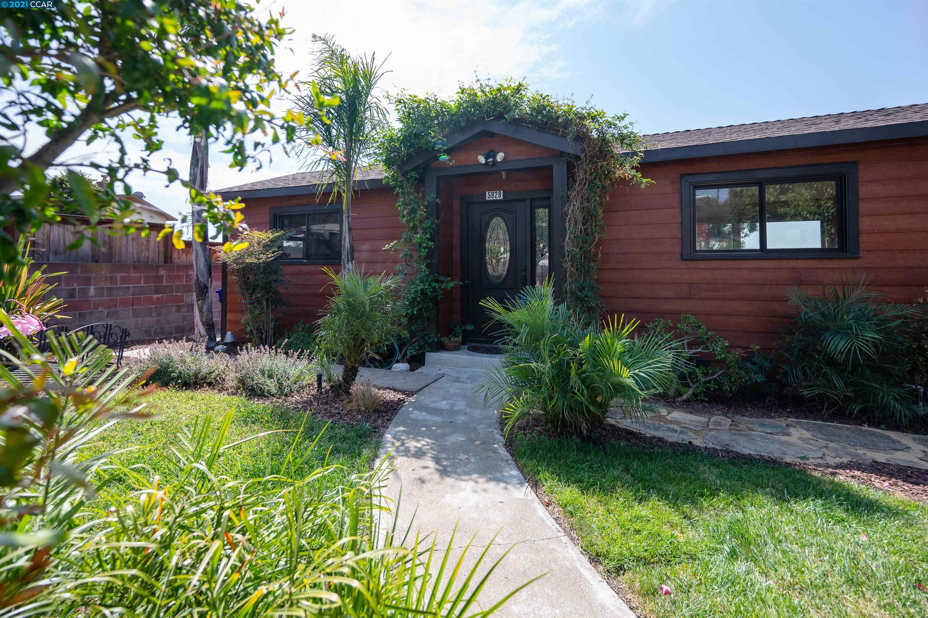 Versatile and unique home recently rebuilt in 2009.  Level-in entry at street level.  3 bedrooms on the street level with one master suite with full bath and another bedroom with half-bath. Downstairs is another bedroom plus an In-Law studio with kitchenette and full bath!  Great opportunity for a large or multi-generational group.  In-law unit could be an income opportunity.  TWO separate outbuildings in the rear can be used as an office, art or music studio or many other uses.  Fantastic Marin and filtered SF views from spacious deck. Over a dozen mature fruit trees around the house.  Quiet cul-de-sac.  Must see!!!