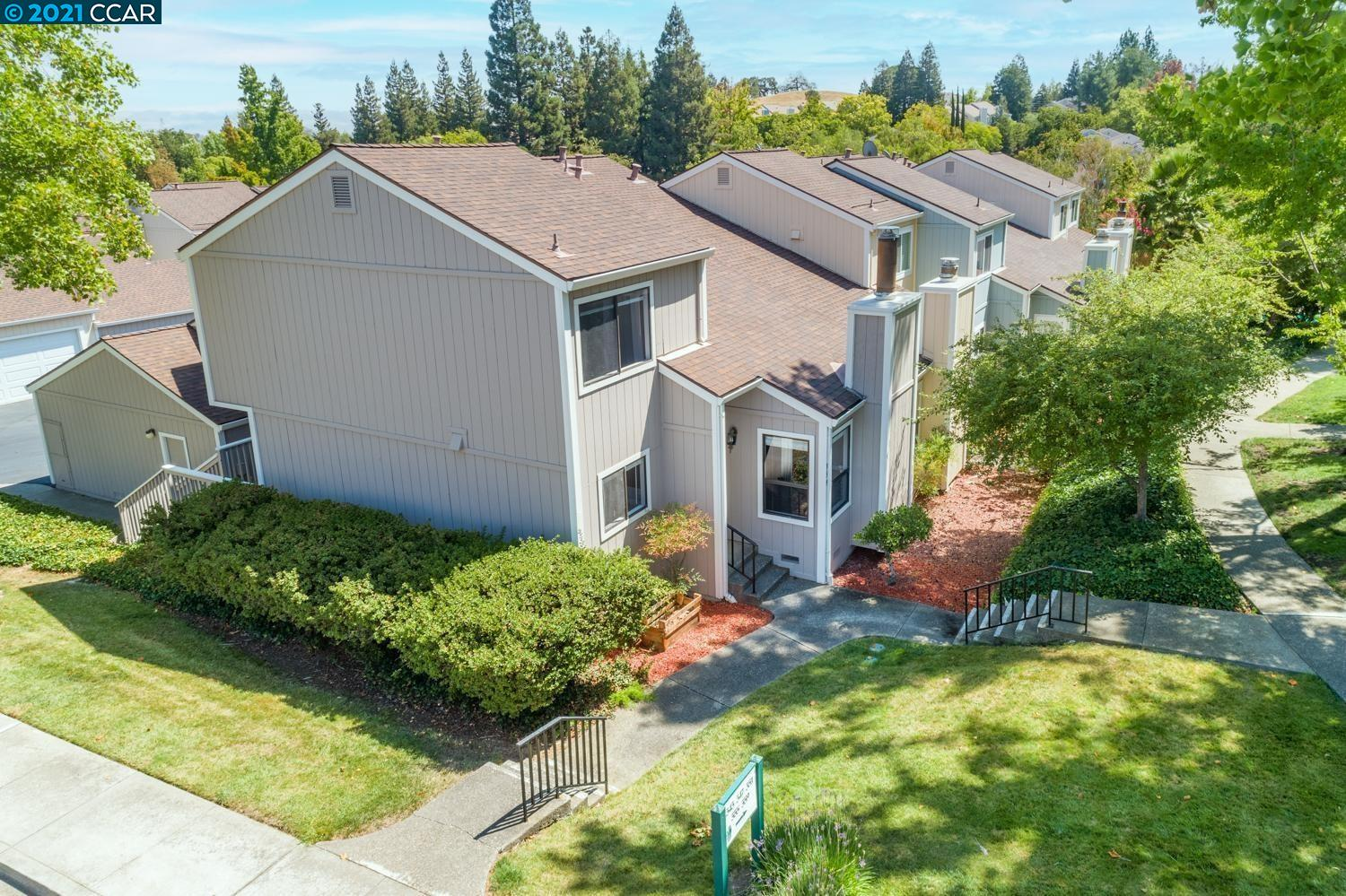 Lovely end unit with lots of light and nearby parking.  Great location facing greenbelt.  Open airy outside deck.  Nicely updated kitchen and bathrooms. Vaulted ceilings.  New carpet, new laminate flooring.  2 car garage. Community pool, spa, tennis courts, basketball & more!