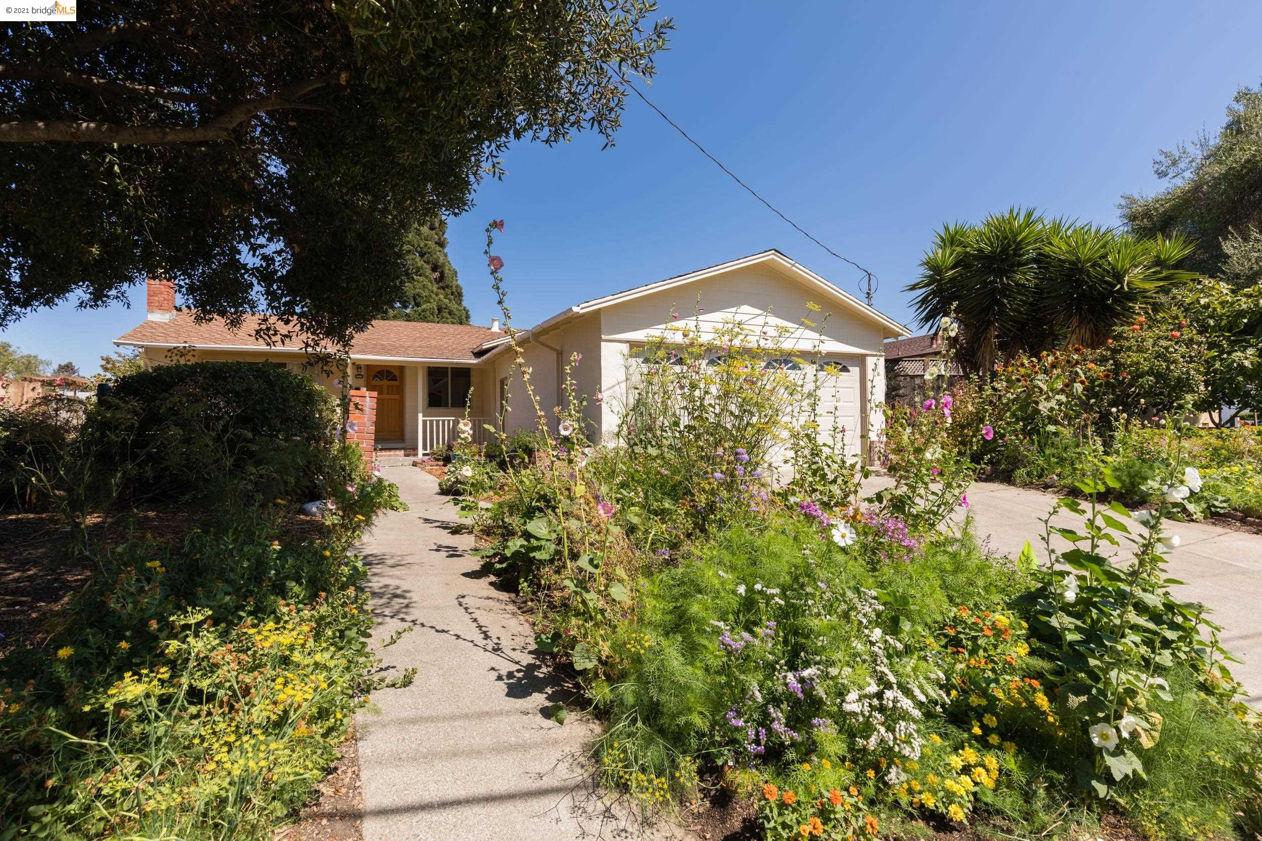 Wonderful Tara Hills 4-bdrm, 2 bath rancher with fabulous gardens! Comfortable floorplan, starting with a big living room with fireplace. Friendly and spacious kitchen-dining area combination. Large primary suite with a private bath and 2 closets. Convenient laundry closet inside. Big windows with views into the gardens let natural light flood throughout the house. Well-established pollinator friendly plantings all around the gardens. Two handsome trees grace the yards, one in front and one in back. Huge garage with convenient roll-up door. Close to schools, shopping and transportation. Sewer compliant! Pride of ownership! Don't miss this one!