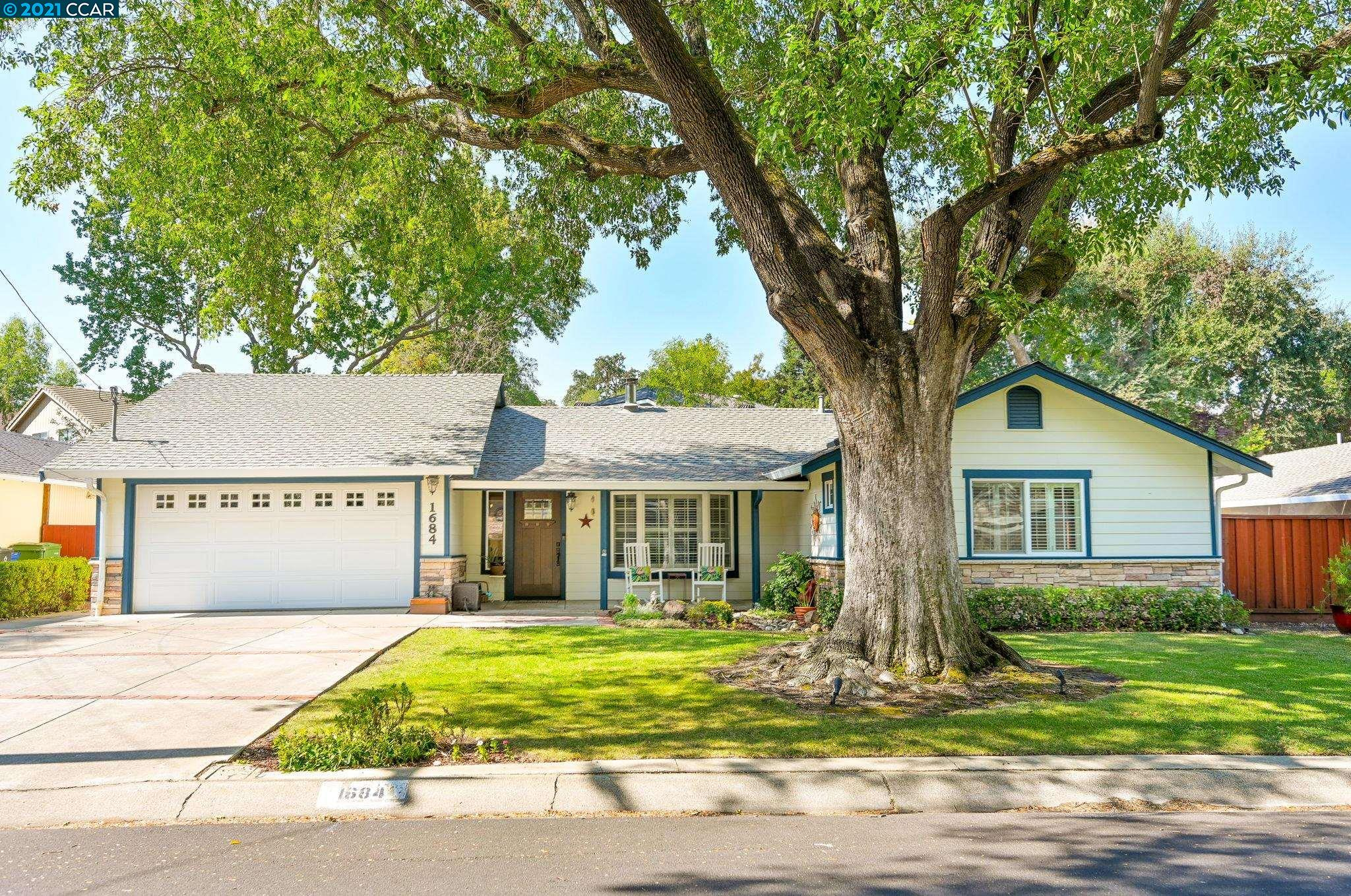Beautifully updated and meticulously maintained rancher in Gregory Gardens. Nestled just a few blocks from Distinguished Elementary, Middle, and High Schools and centrally located for easy commute in all directions. Quiet tree-lined street, close to bike paths and a nice walk to downtown. Sunlight drenched front room through Plantation shutters and a wood-burning stove. Hardwood flooring and eco-friendly ceiling fans through most of the house. Updated kitchen has solid-surface countertops and modern, green-friendly stainless steel electric range with convection self-cleaning oven and separate built-in microwave opening to dining area. Bonus room through barn door leads to workout/ rumpus room (not included in sq ft). MBR Suite and Bath with solid surface cabinet tops and tile flooring while Hall bath has shower over tub. Attached garage features plenty of storage in cabinets and overhead. Come see your future home on one of the nicest streets in Pleasant Hill!