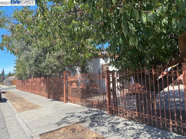 Corner lot house, with lots of fruit trees, kumquat, fig, cherries, olives and plums!! Property is well maintained and vacant with 2 bedroom/1bath and excellent for investment or first time home buyers w/o the wait of an eviction! Patio room can be used as an extra room! Laundry room in the back! New carpet and paint throughout! RV parking in side yard! Elegant iron fence! Lots of off-street parking! Nice fountain and bench in front yard with beautiful garden! Shed in the back can be easily converted into a studio for extra income!
